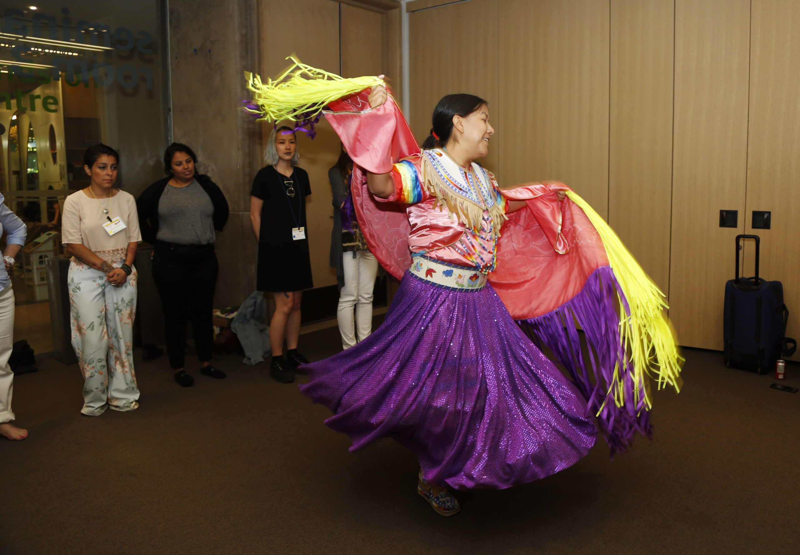 Indigenous woman teaching fancy shawl dance
